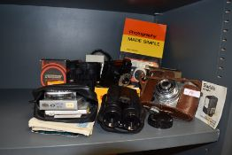 A selection of vintage cameras and accessories,binoculars and book also included.