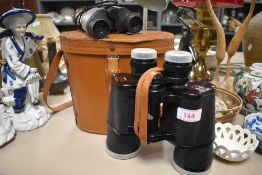 A pair of Daylite deluxe 10x50 binoculars and a similar pair