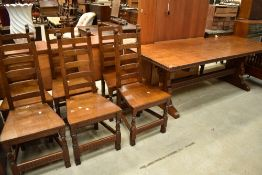 A top quality oak refectory style dining table and set of six ladder back chairs in the period