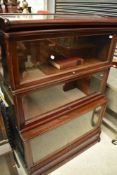 An early 20th Century mahogany stacking bookcase unit , having three glazed tiers, unlabelled but in