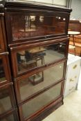 An early 20th Century mahogany and stained frame stacking bookcase unit base having four glazed