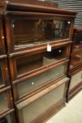 An early 20th Century oak stacking bookcase unit , having drawer base and four glazed tiers,