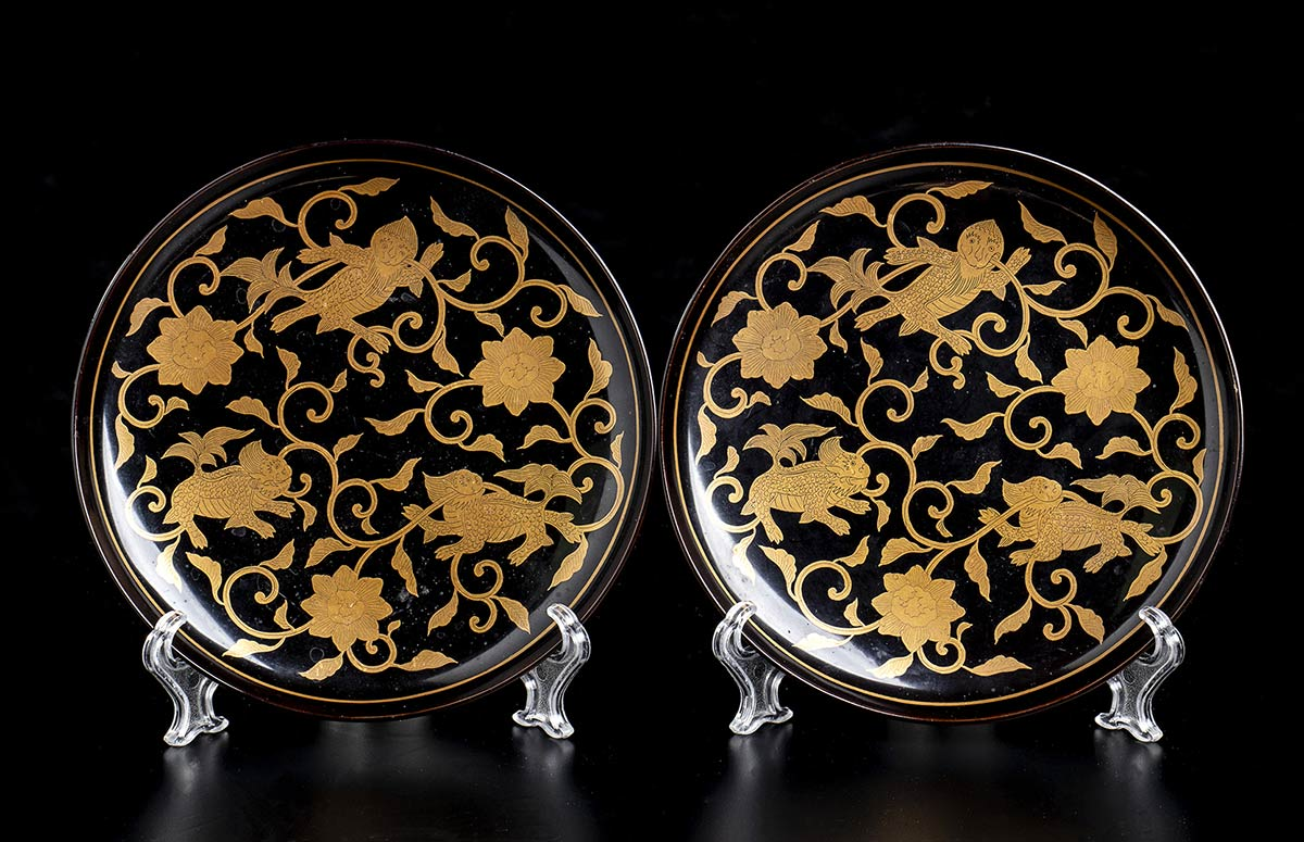 A PAIR OF LACQUERED AND GILT WOOD SAUCERS Japan, Meiji period