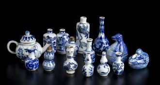 FOURTEEN MINIATURE 'BLUE AND WHITE' PORCELAIN CONTAINERSChina, Kangxi period and later