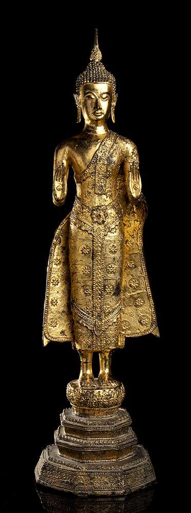 A GILT METAL STANDING BUDDHA Thailand, 20th century