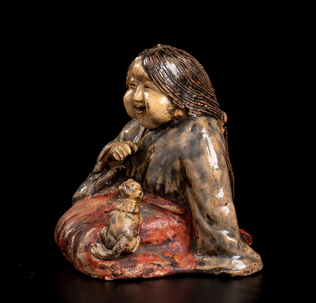 A GLAZED AND PAINTED CERAMIC SCULPTURE OF OKAME WITH A DOGJapan, Meiji period - Image 2 of 2