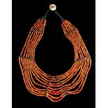 A BREAST NECKLACE WITH ORANGE BEADS