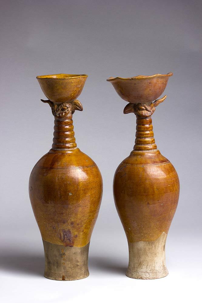 A PAIR OF AMBER-GLAZED CERAMIC 'PHOENIX HEAD' VASESChina, Liao dynasty
