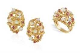 AN OPAL AND RUBY COCKTAIL RING WITH MATCHING EARCLIPS, of openwork bombé design highlighted with