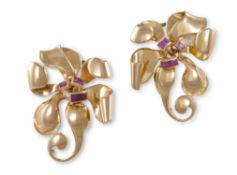 A PAIR OF RUBY AND GOLD DOUBLE CLIP BROOCHES CIRCA 1945, each flowerhead with scrolling design and
