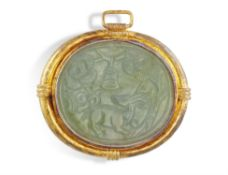 A JADEITE JADE PENDANT, composed of a large oval green jadeite jade with engravings depicting a