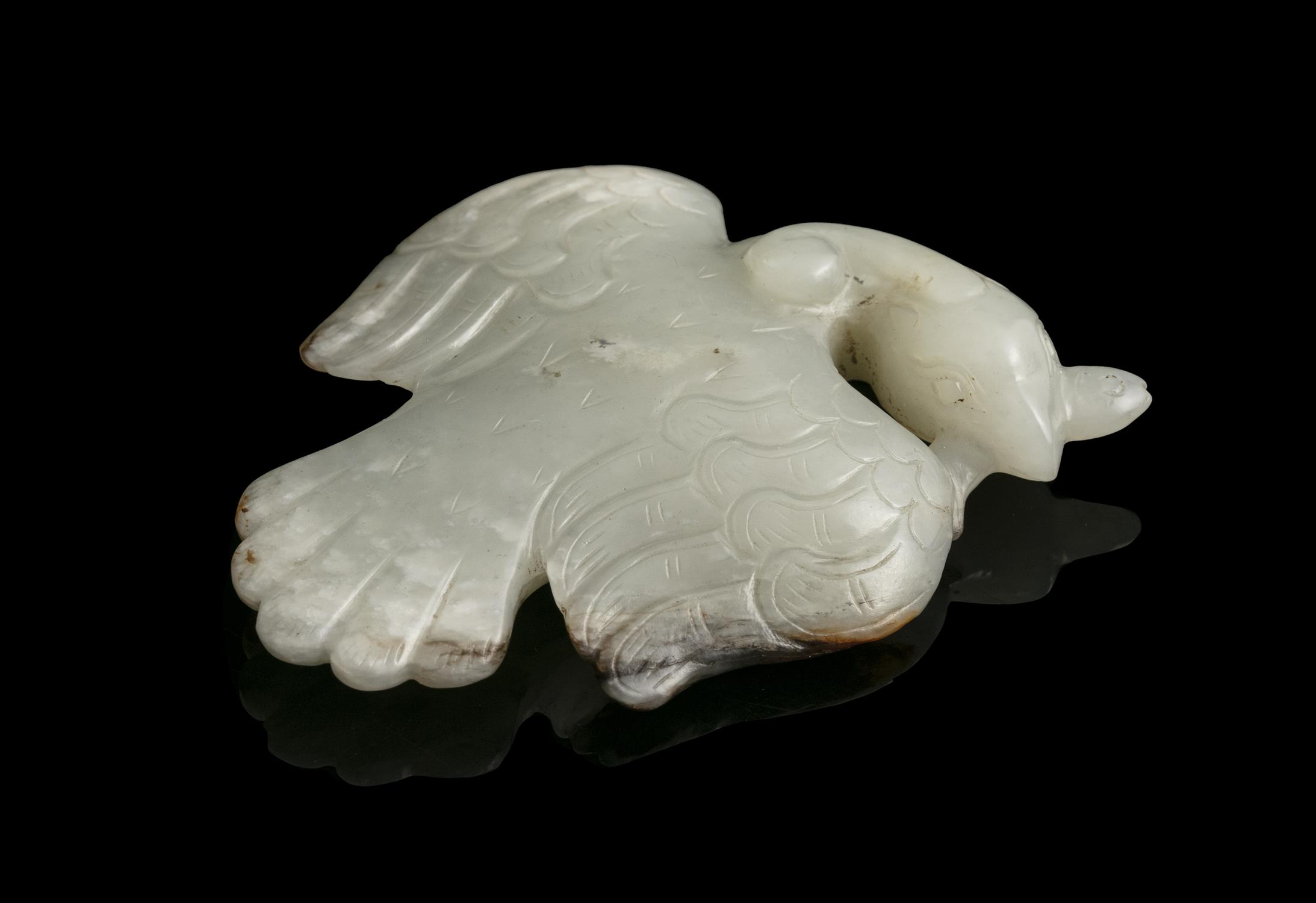 A MOTTLED JADE CARVING OF A FLYING PHOENIX China Depicted as flying, the wings with engraved curly - Image 13 of 17