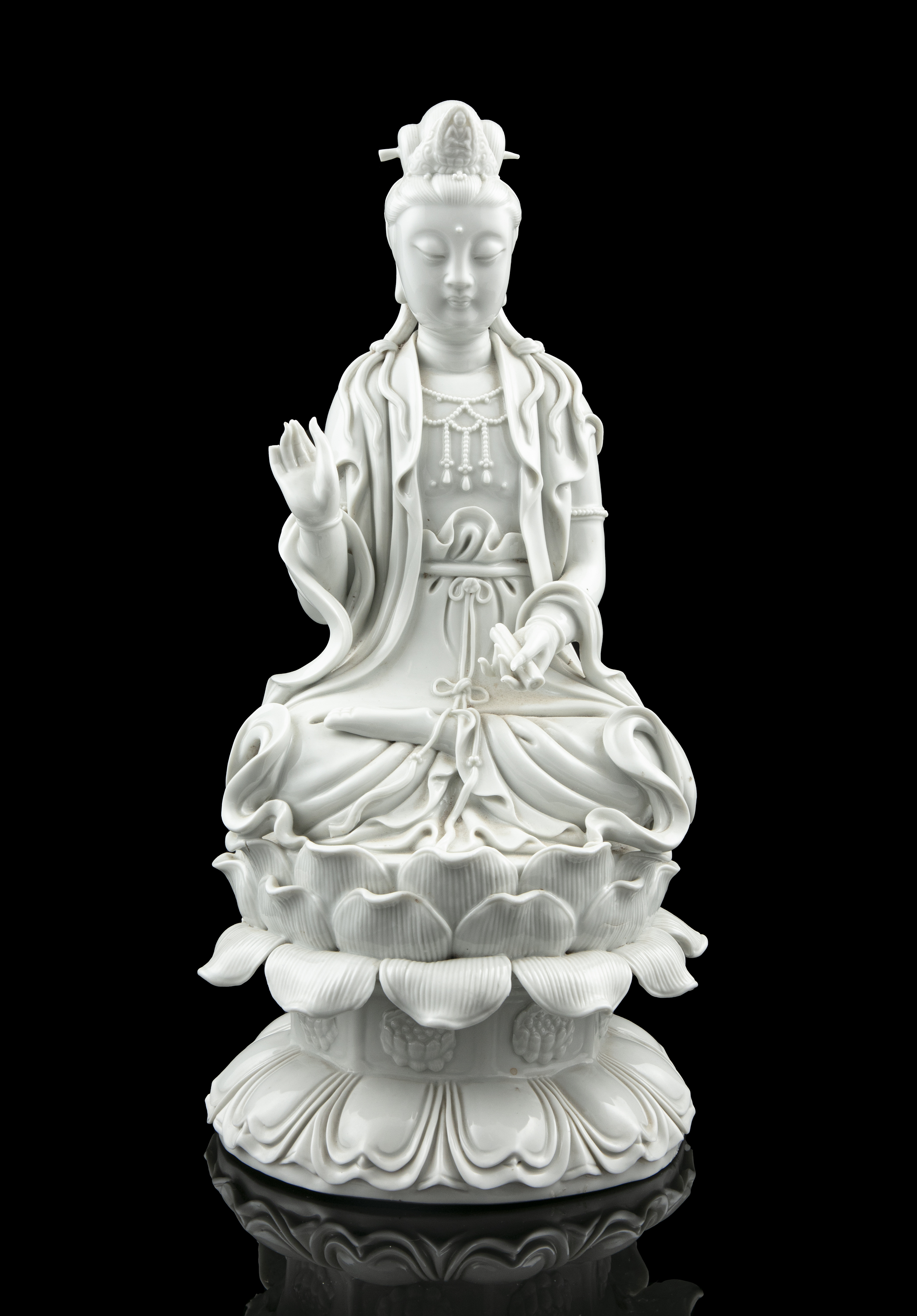 A LARGE DEHUA FIGURE OF A SEATED GUANYIN China, 19th to 20th century The goddess of mercy is