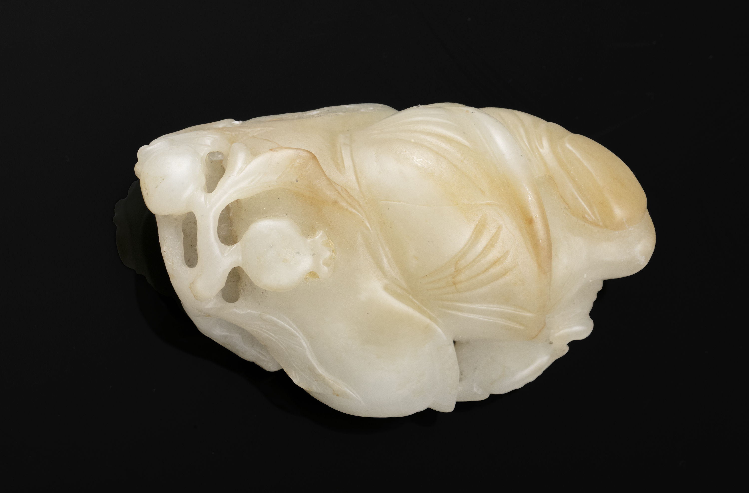 A WHITE AND RUSSETS JADE CARVING OF A HOHO / HEHE / ERXIAN / 和合二仙 China The boy is depicted grasping - Image 10 of 20