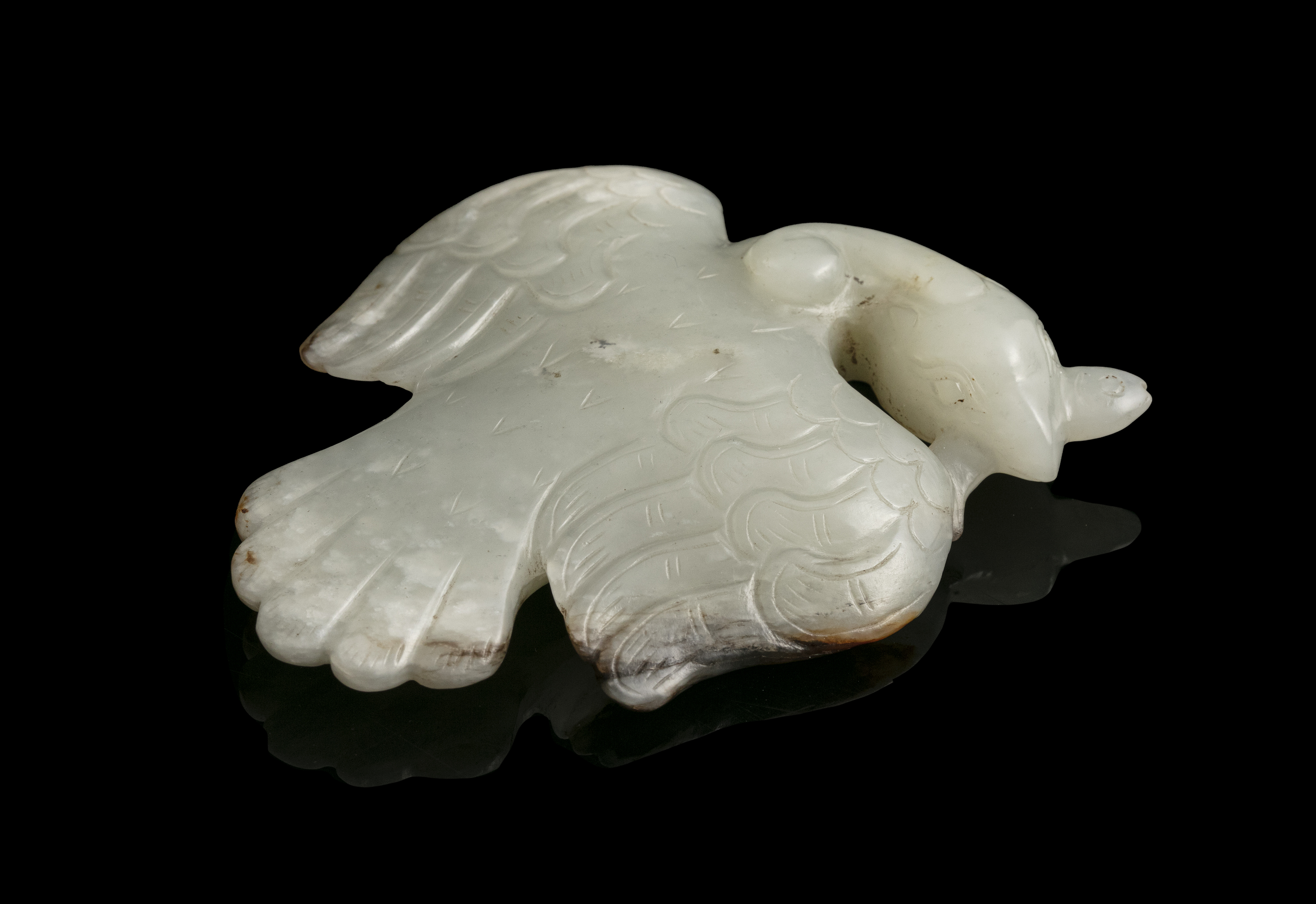 A MOTTLED JADE CARVING OF A FLYING PHOENIX China Depicted as flying, the wings with engraved curly - Image 2 of 17