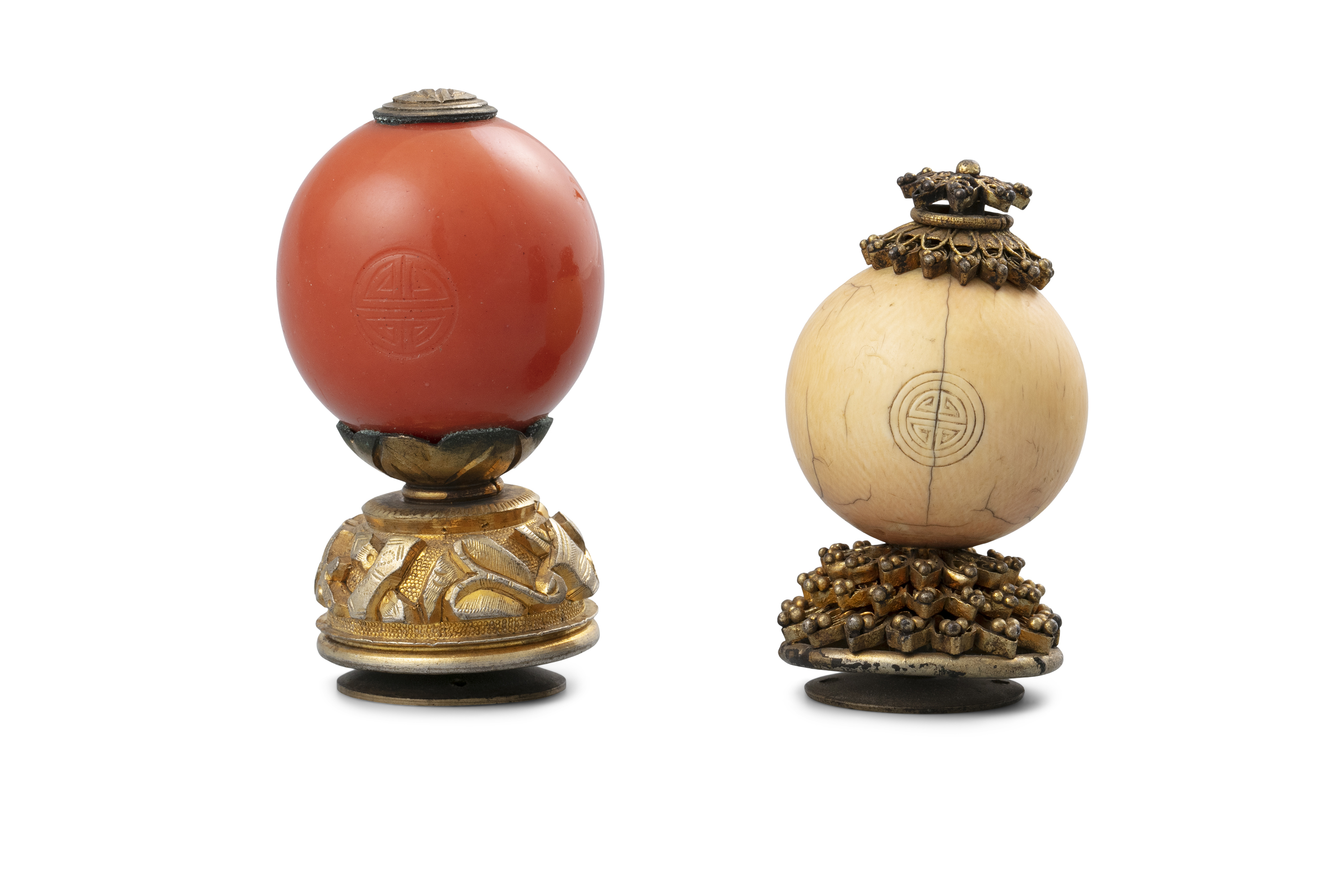 *A GROUP OF TWO MANDARIN HAT FINIALS China, Qing Dynasty, 19th century One with a likely coral red