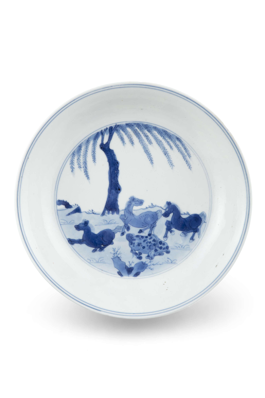 A BLUE AND WHITE 'EIGHT HORSES OF WANG MU' PORCELAIN DISH China, Qing Dynasty, Kangxi mark and