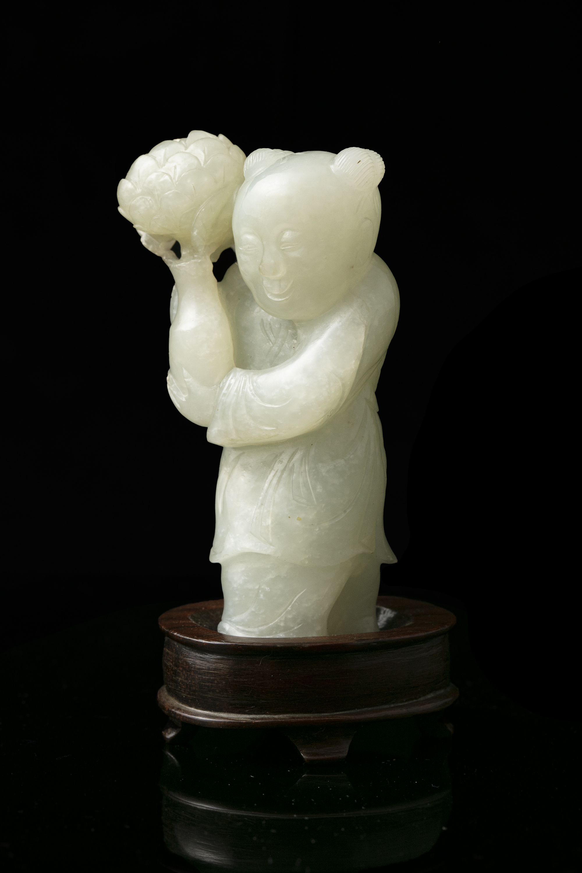 A WHITE JADE FIGURE OF A STANDING BOY WITH A LOTUS FLOWER VASE China, Qing Dynasty, 19th century - Image 2 of 14
