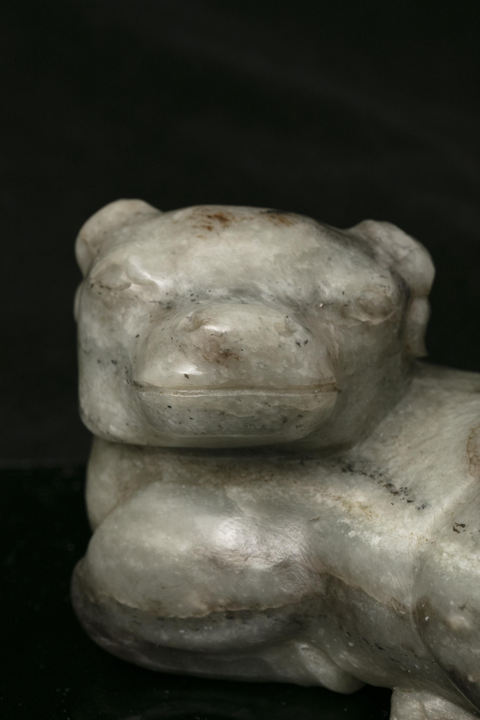 A MOTTLED JADE CARVING OF A RECUMBENT WATER BUFFALO China, Qing Dynasty The crouching beast with its - Image 4 of 17
