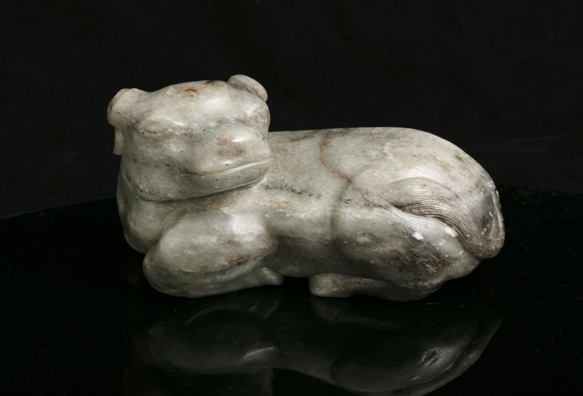 A MOTTLED JADE CARVING OF A RECUMBENT WATER BUFFALO China, Qing Dynasty The crouching beast with its - Image 2 of 17