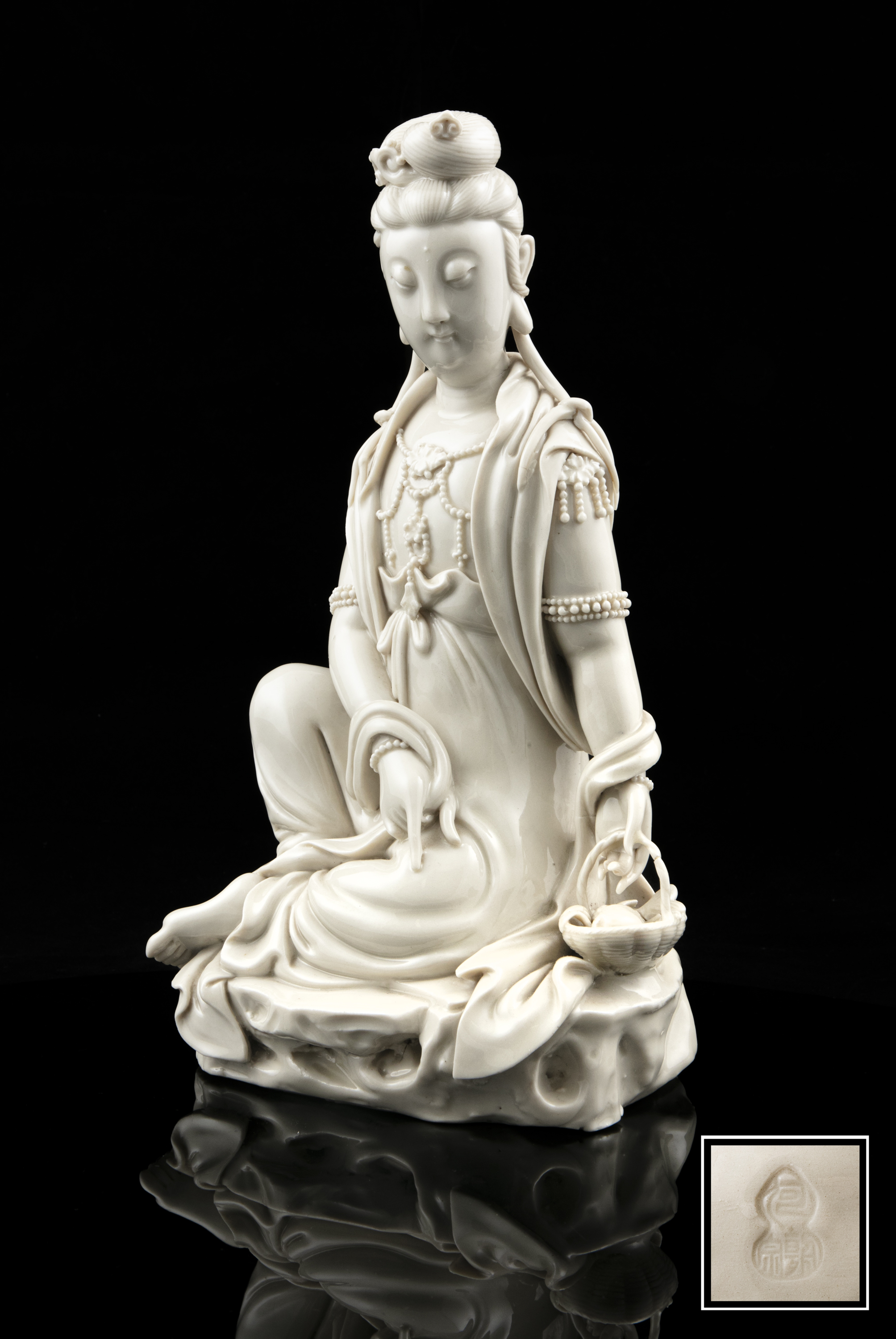 A LARGE DEHUA FIGURE OF A SEATED GUANYIN IMPRESSED WITH A HE CHAOZONG 何朝宗 CALABASH SHAPED SEAL