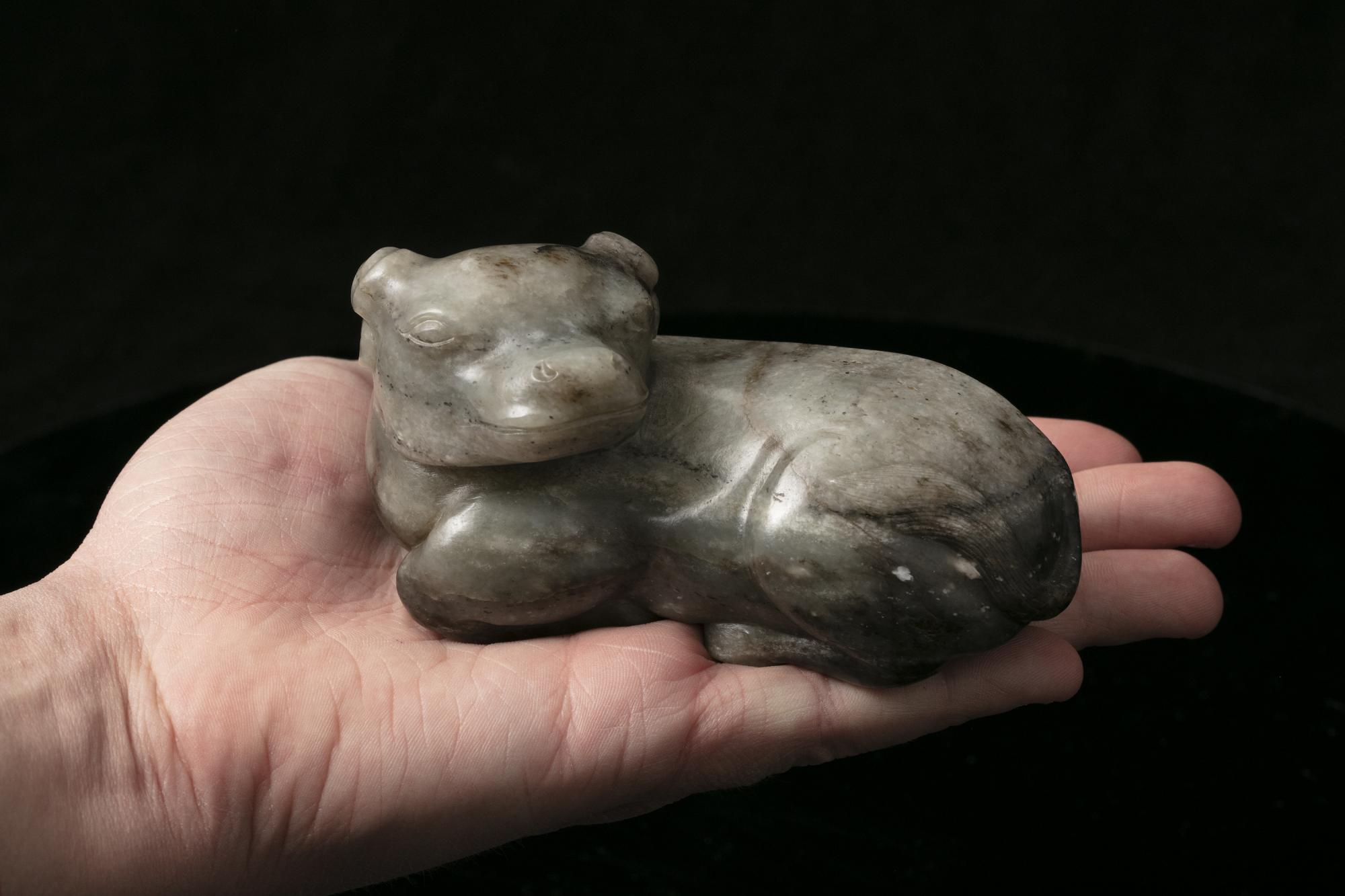 A MOTTLED JADE CARVING OF A RECUMBENT WATER BUFFALO China, Qing Dynasty The crouching beast with its - Image 9 of 17
