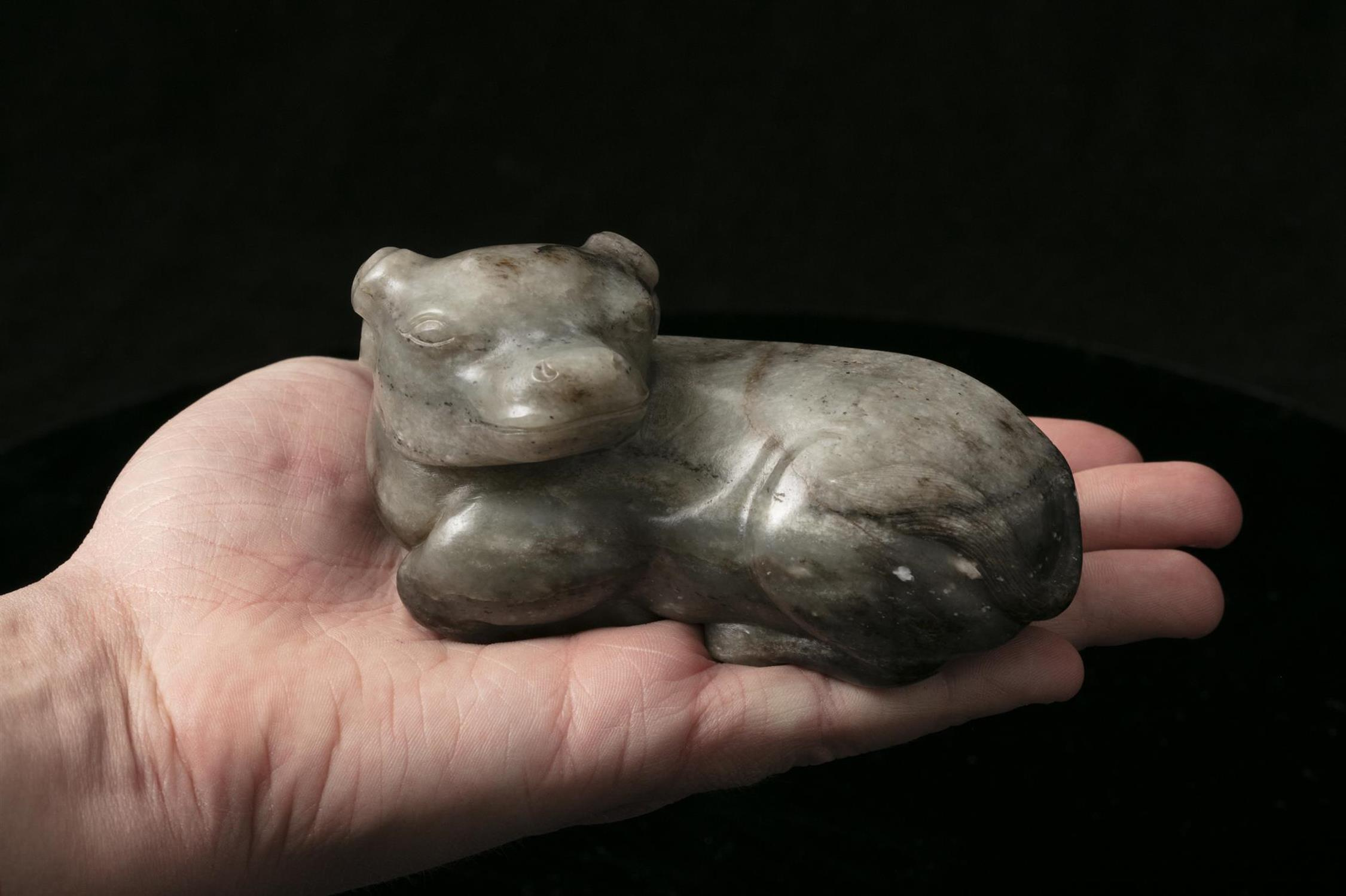 A MOTTLED JADE CARVING OF A RECUMBENT WATER BUFFALO China, Qing Dynasty The crouching beast with its - Image 16 of 17