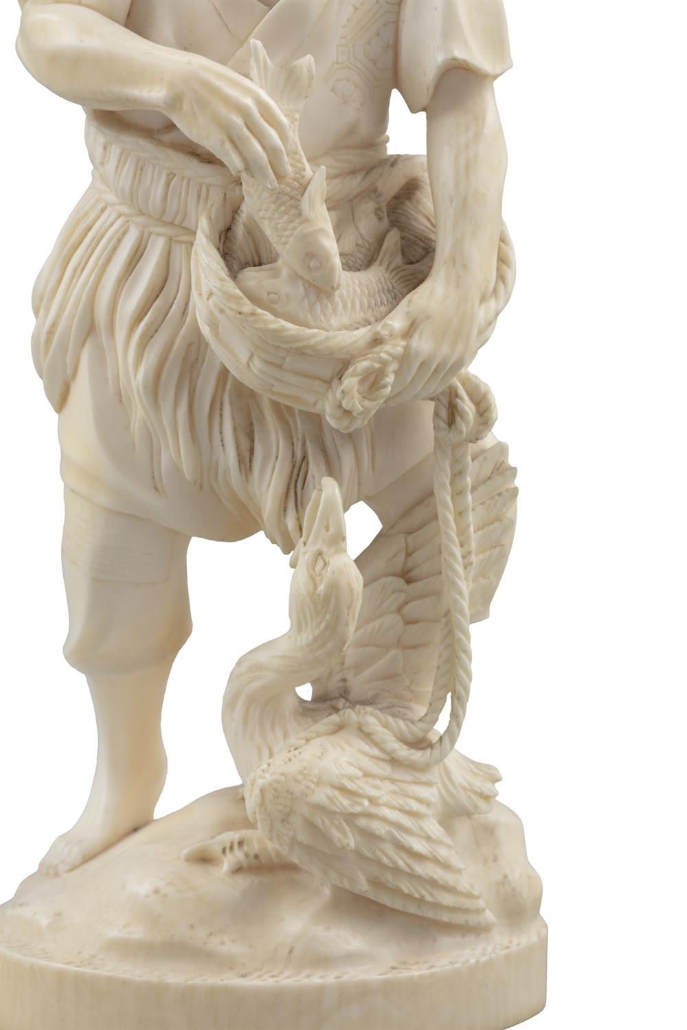 *AN IVORY OKIMONO OF A MAN WITH A BASKET FISH AND A CORMORAN Japan, Meiji period With signature to - Image 6 of 8