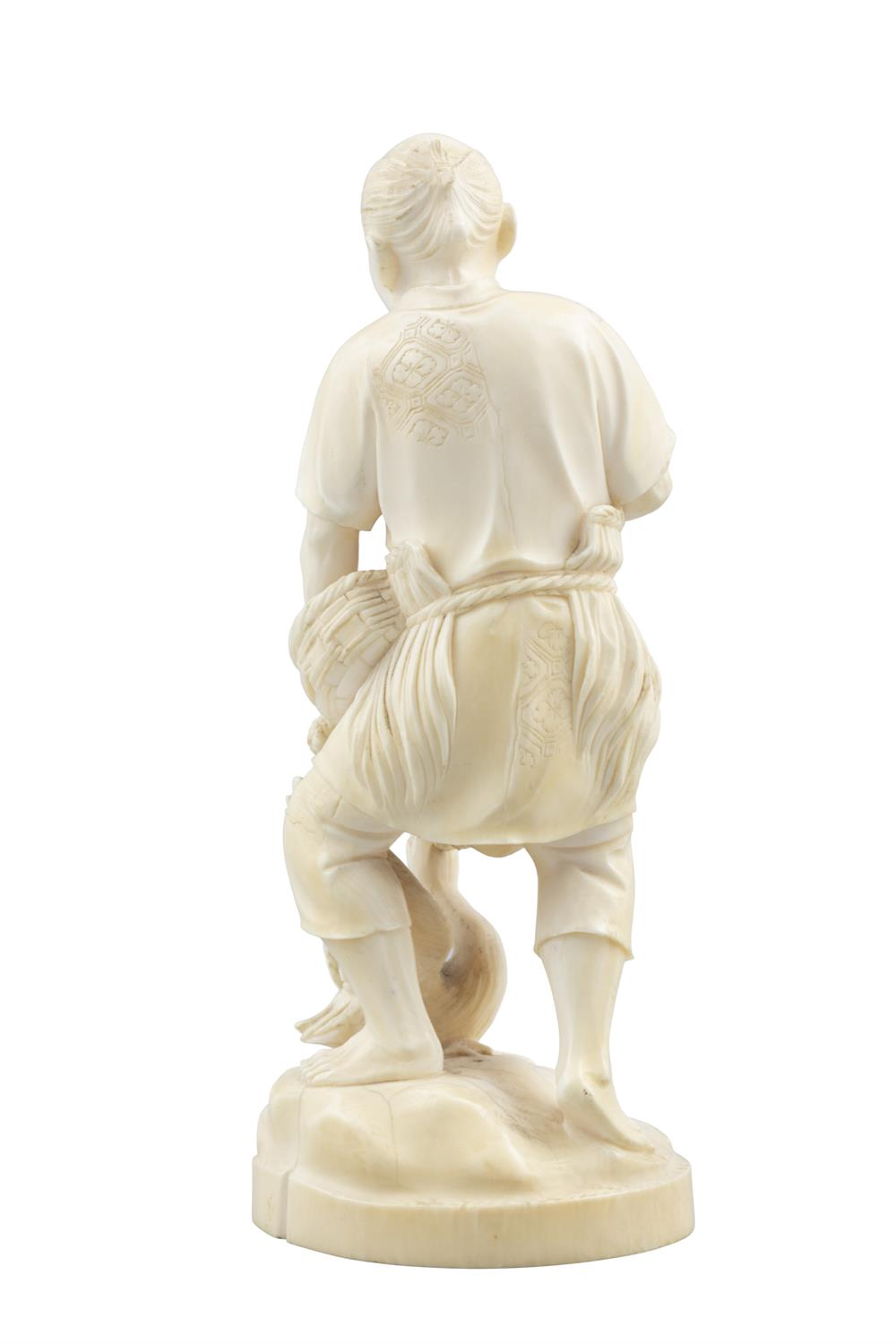 *AN IVORY OKIMONO OF A MAN WITH A BASKET FISH AND A CORMORAN Japan, Meiji period With signature to - Image 7 of 8