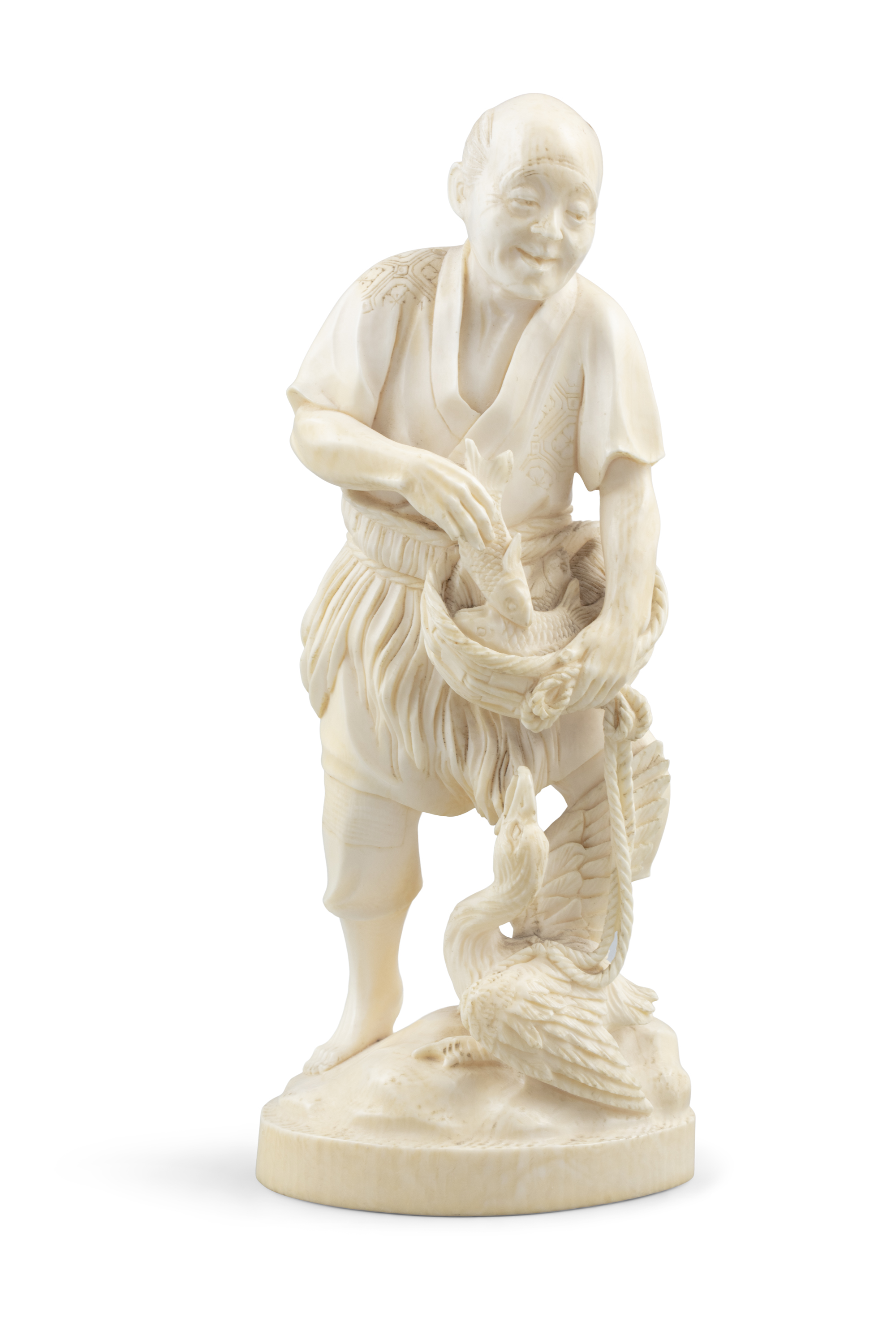 *AN IVORY OKIMONO OF A MAN WITH A BASKET FISH AND A CORMORAN Japan, Meiji period With signature to