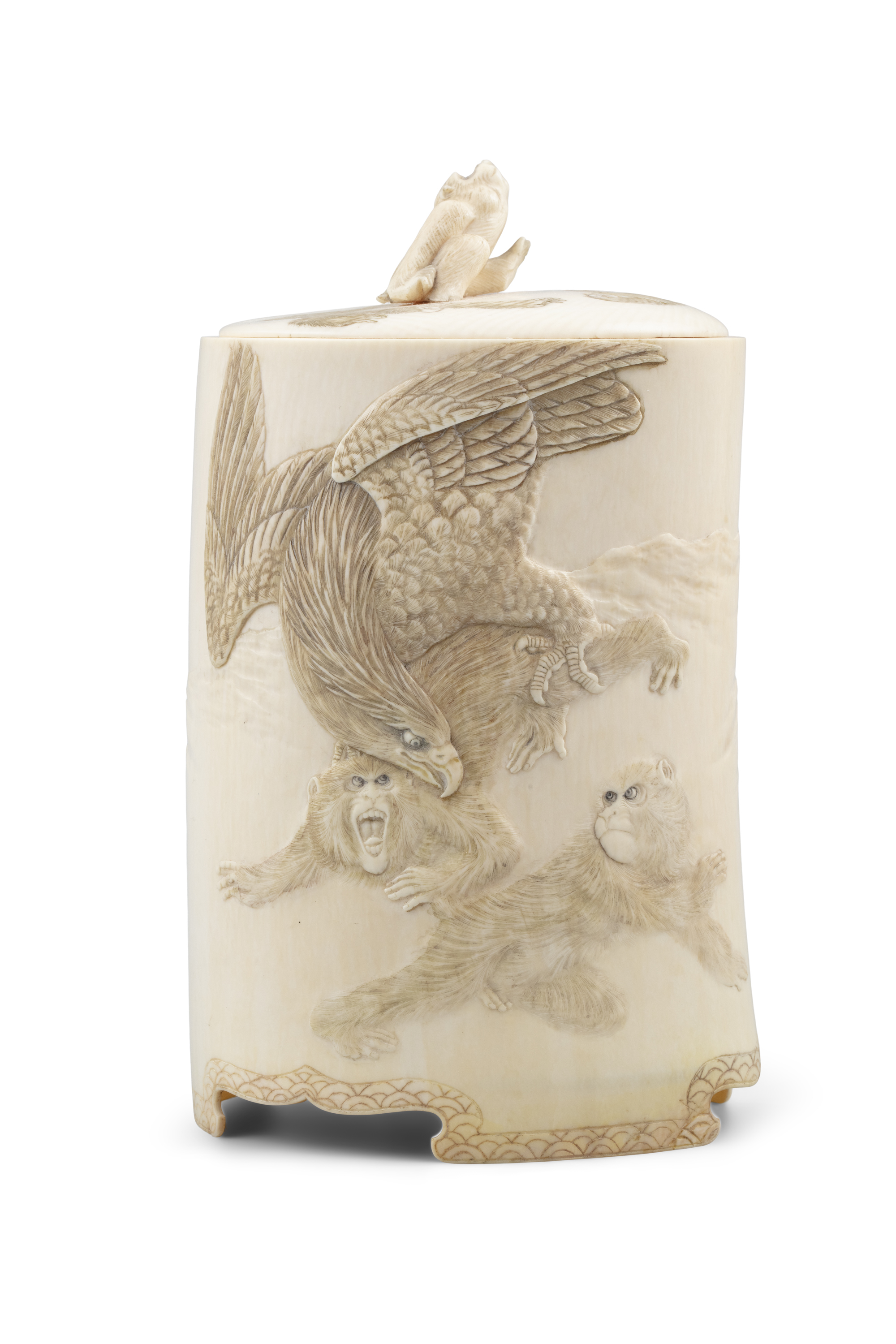 *AN IVORY 'MONKEYS AND EAGLE' BOX AND COVER Japan, Meiji period The outer is adorned in low-relief