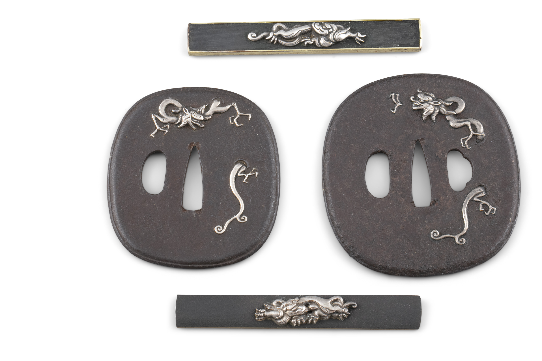 A PAIR OF 'RAIN DRAGONS' WROUGHT-IRON TSUBAS Japan, 19th century The first one for a katana,