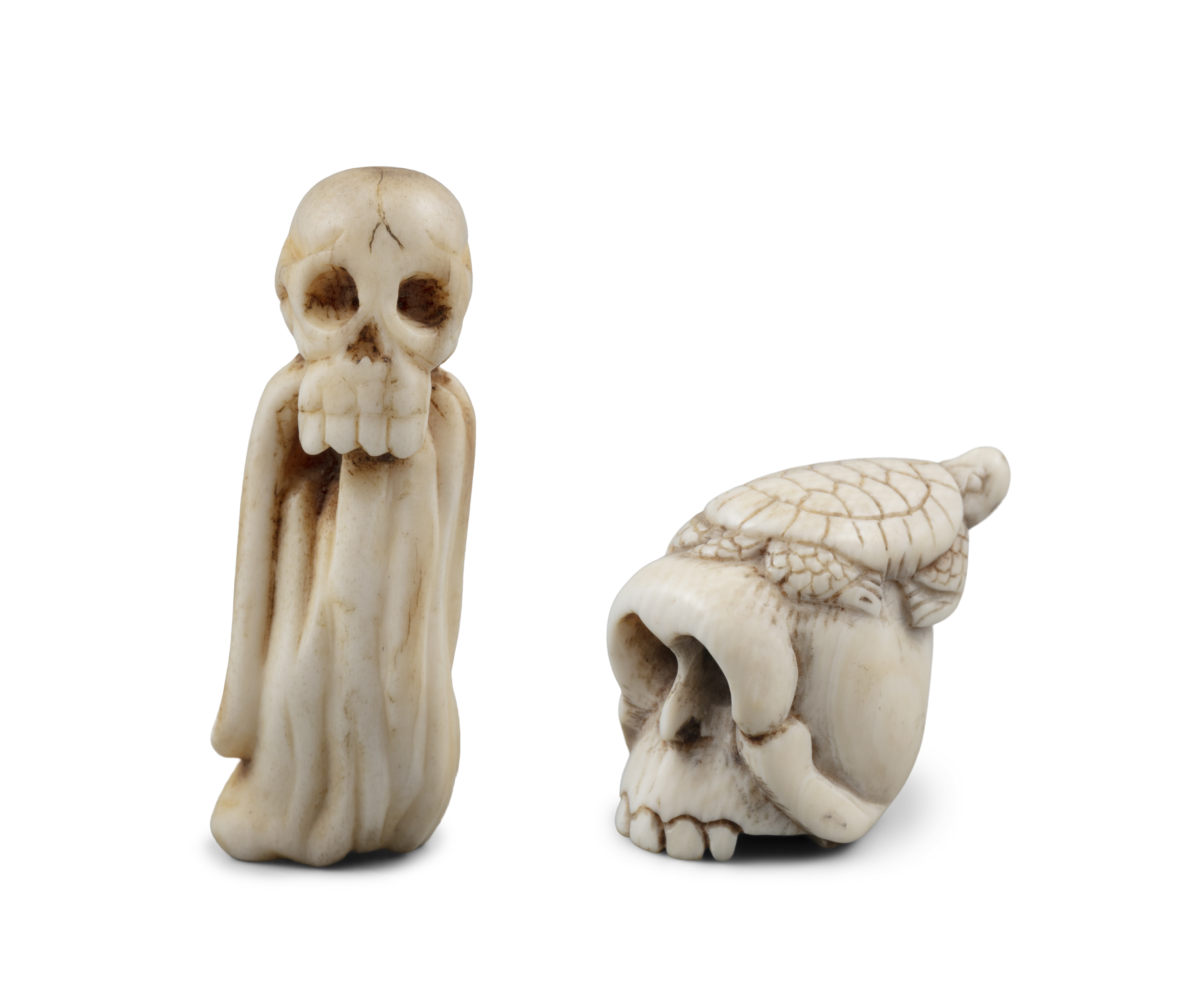 *VANITY - A GROUP OF TWO (2) 'SKULL' KATABORI NETSUKE Japan, 19th century The first one carved out