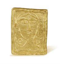 A RARE AND COLLECTIBLE GOLD 'PETITE TÊTE CARÉE' PENDANT, BY ANDRÉ DERAIN (1880-1954) A rare 23K