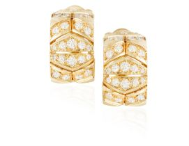 A PAIR OF DIAMOND EARCLIPS, BY CARTIER Each thick openwork hoop with geometric pattern set