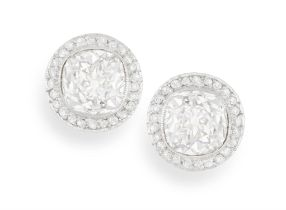 A PAIR OF DIAMOND EARSTUDS Each old cushion-shaped diamond within collet-setting and a halo of