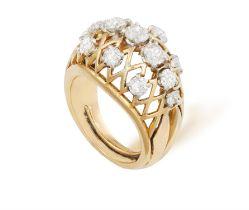 A RETRO DIAMOND RING, CIRCA 1950 Of domed openwork design, set with old brilliant-cut diamonds,