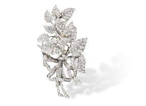 A LATE 19TH CENTURY DIAMOND FLOWER BROOCH Of foliate design, the leaf and bud spray set