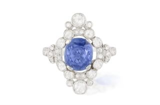 AN EARLY 20TH CENTURY SAPPHIRE AND DIAMOND DRESS RING The cushion-shaped sapphire within a