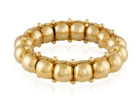 A GOLD RETRO BRACELET, CIRCA 1955 Composed of an articulated line of spherical links between