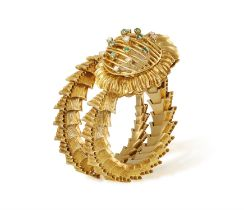 AN 18K GOLD RETRO WATCH, BY LONGINES, CIRCA 1965 The coiled textured gold serpent bracelet with
