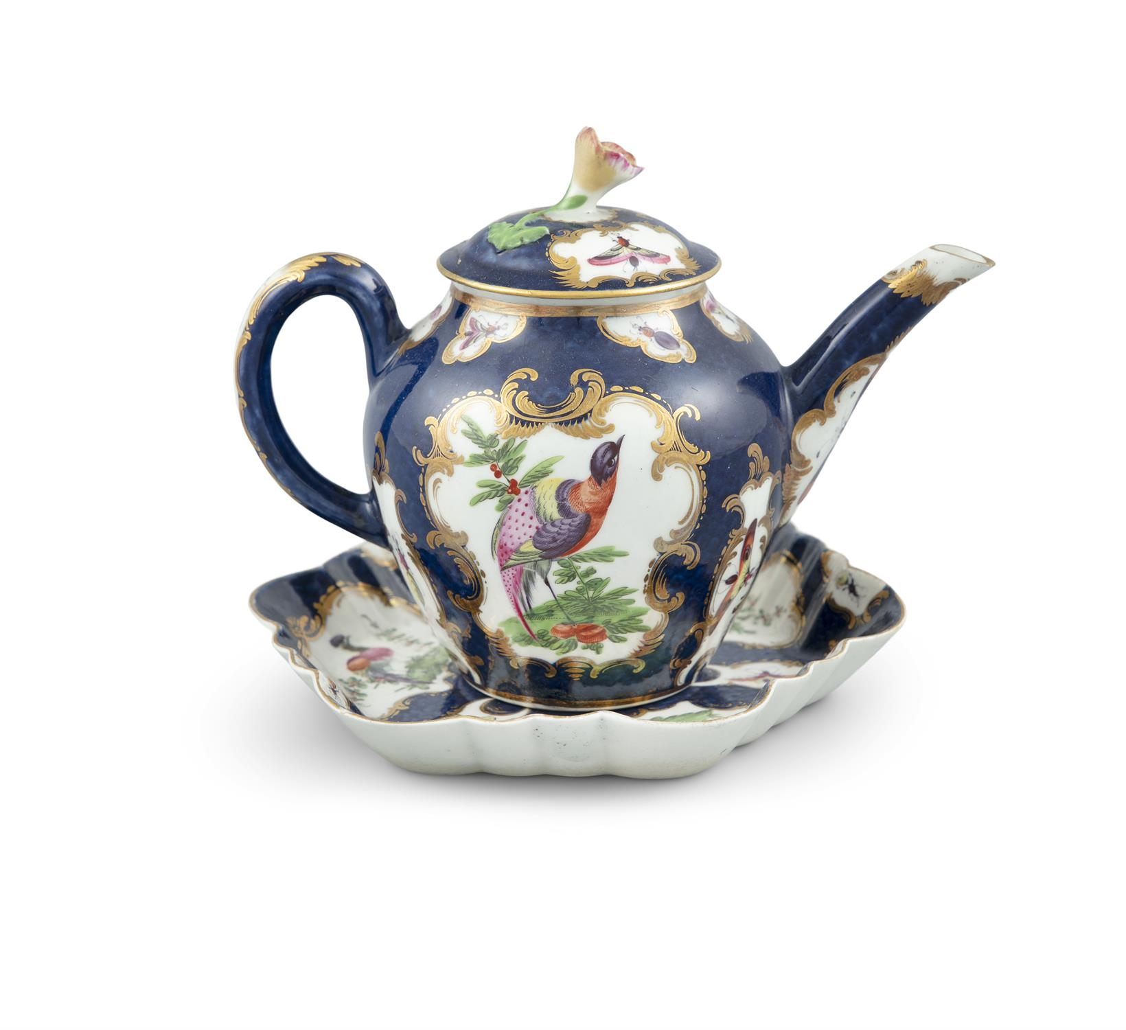 A WORCESTER PORCELAIN BACHELOR'S TEAPOT AND STAND, the deep blue ground decorated with panels