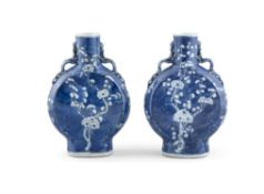 A PAIR OF CHINESE BLUE AND WHITE MOON FLASKS, 19th century, of flattened baluster form,