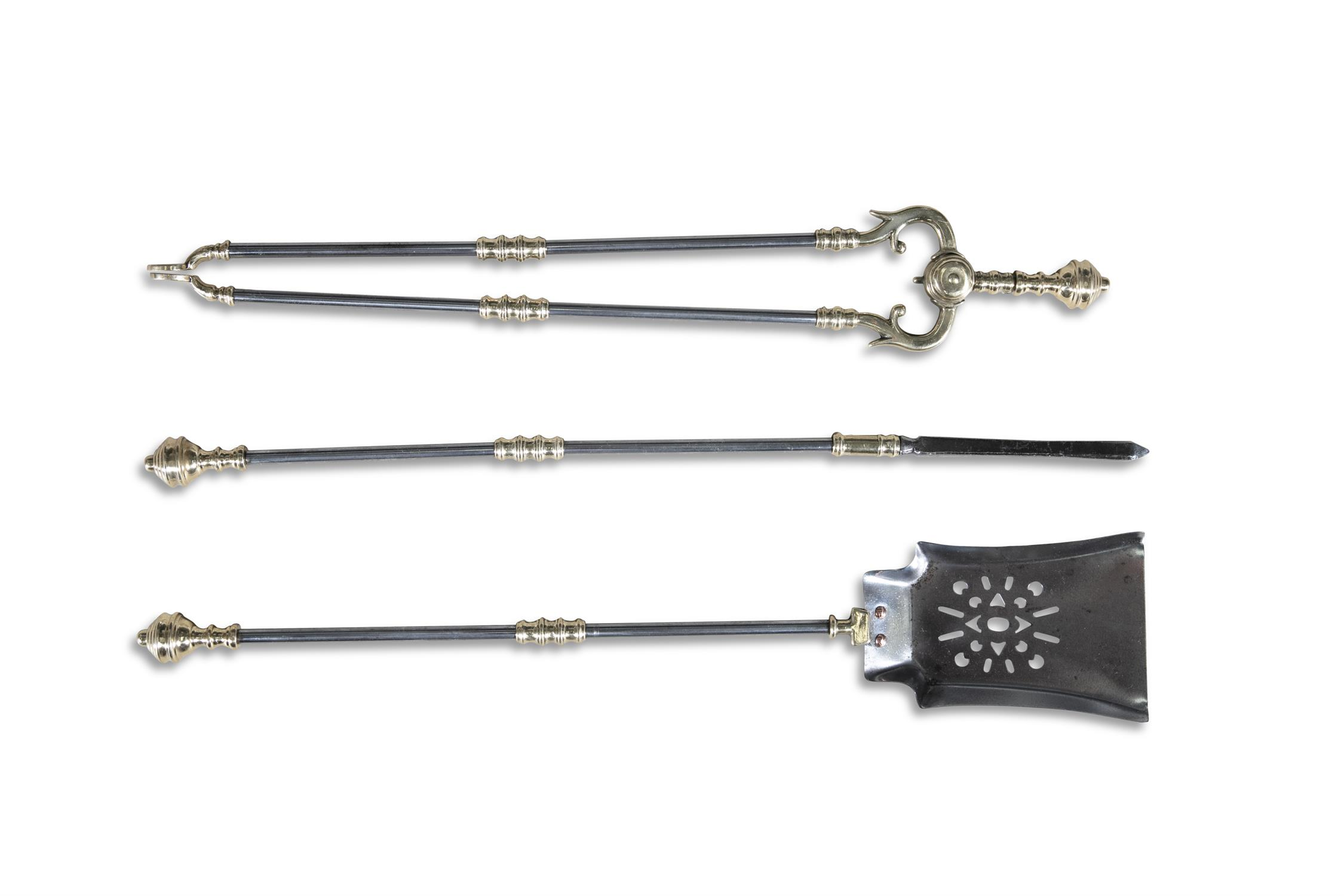A SET OF THREE STEEL AND BRASS FIRE IRONS, comprising poker, shovel and fire tongs.