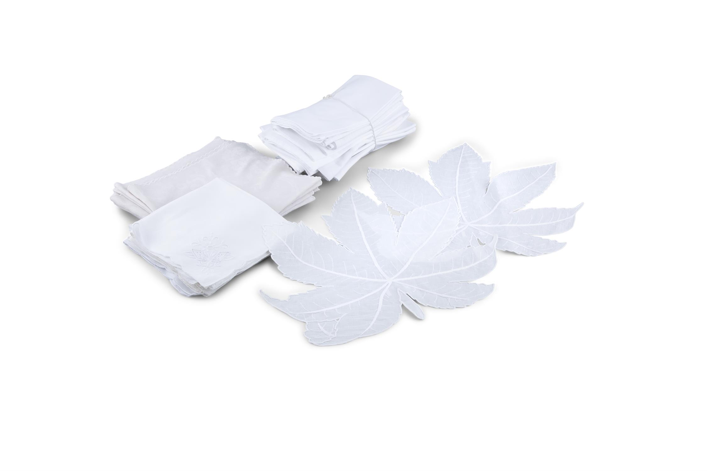 A COLLECTION OF WHITE AND OFF-WHITE TABLE LINENS AND DAMASK, mats and matching napkins,