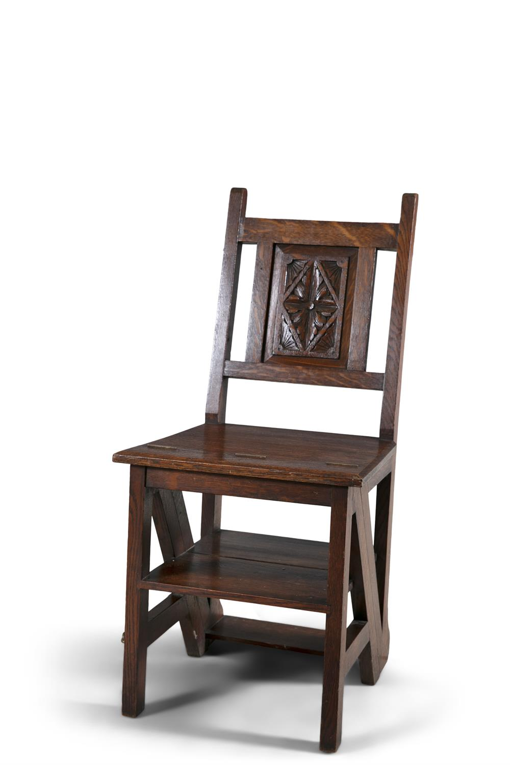 A VICTORIAN MAHOGANY FRAMED METAMORPHIC LIBRARY STEPS/SIDE CHAIR, with H-framed back with carved
