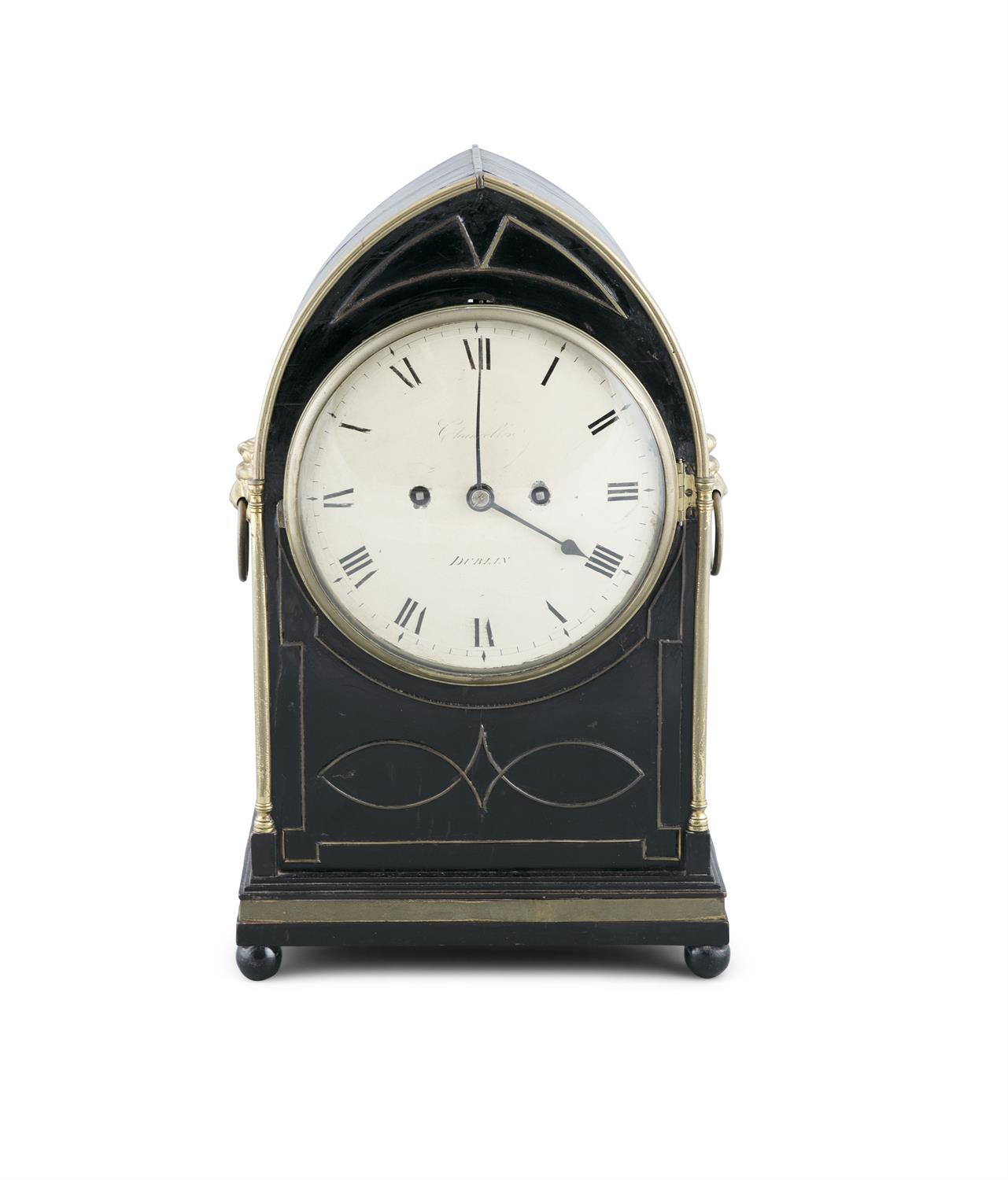 AN IRISH EBONISED MANTLE CLOCK, by Chancellor, Dublin, of arched shape, the body with lion mask