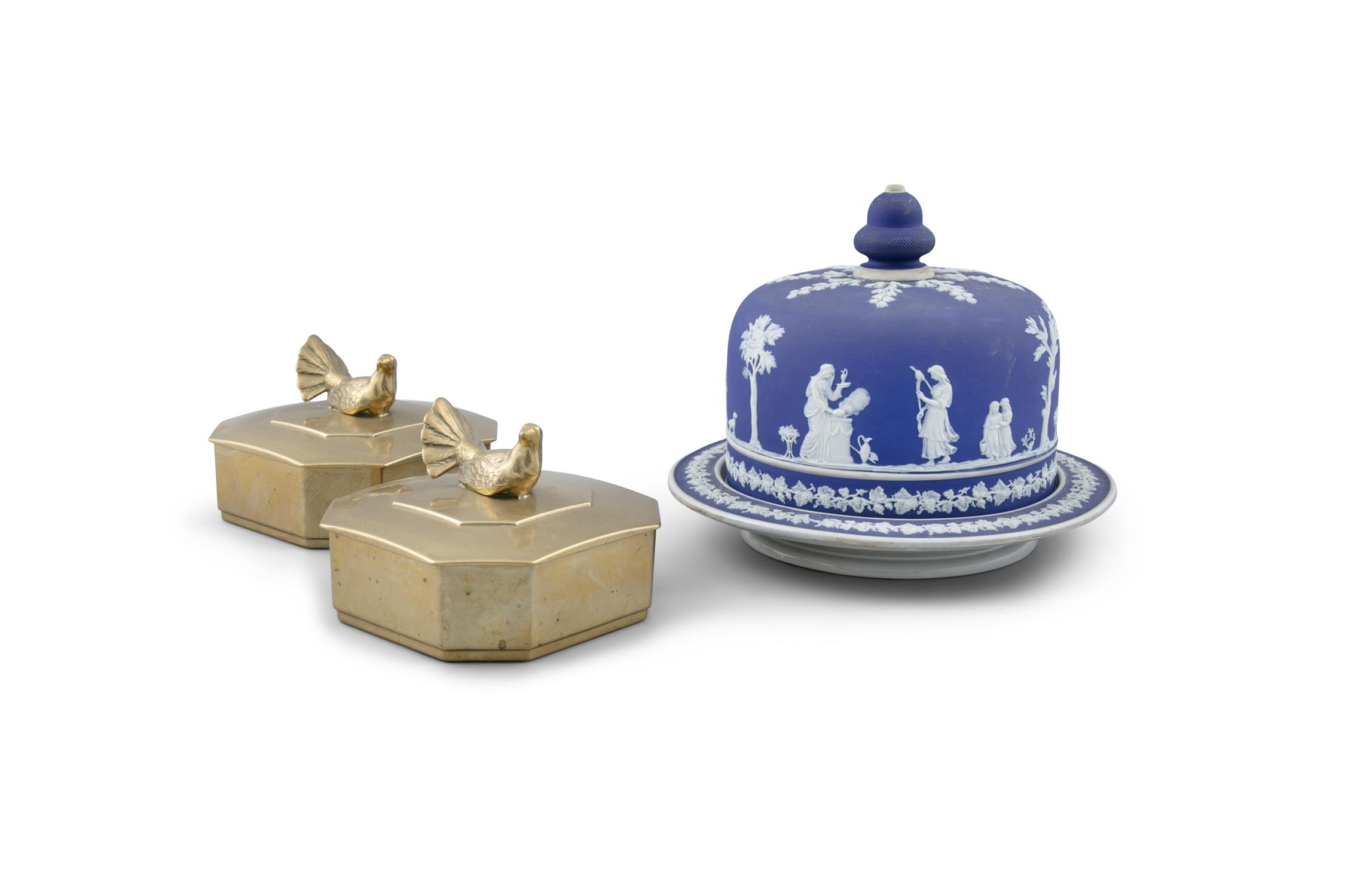 A JASPERWARE CHEESE DISH AND COVER, decorated in white slip with classical figures against a blue