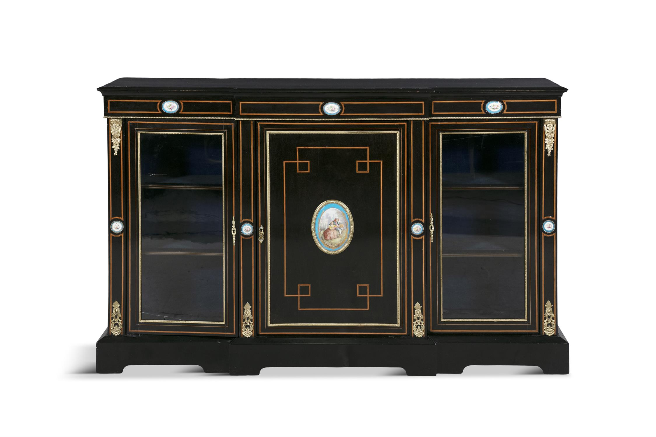 A 19TH CENTURY BRASS MOUNTED EBONISED BREAKFRONT CREDENZA, the plain top with moulded rim above