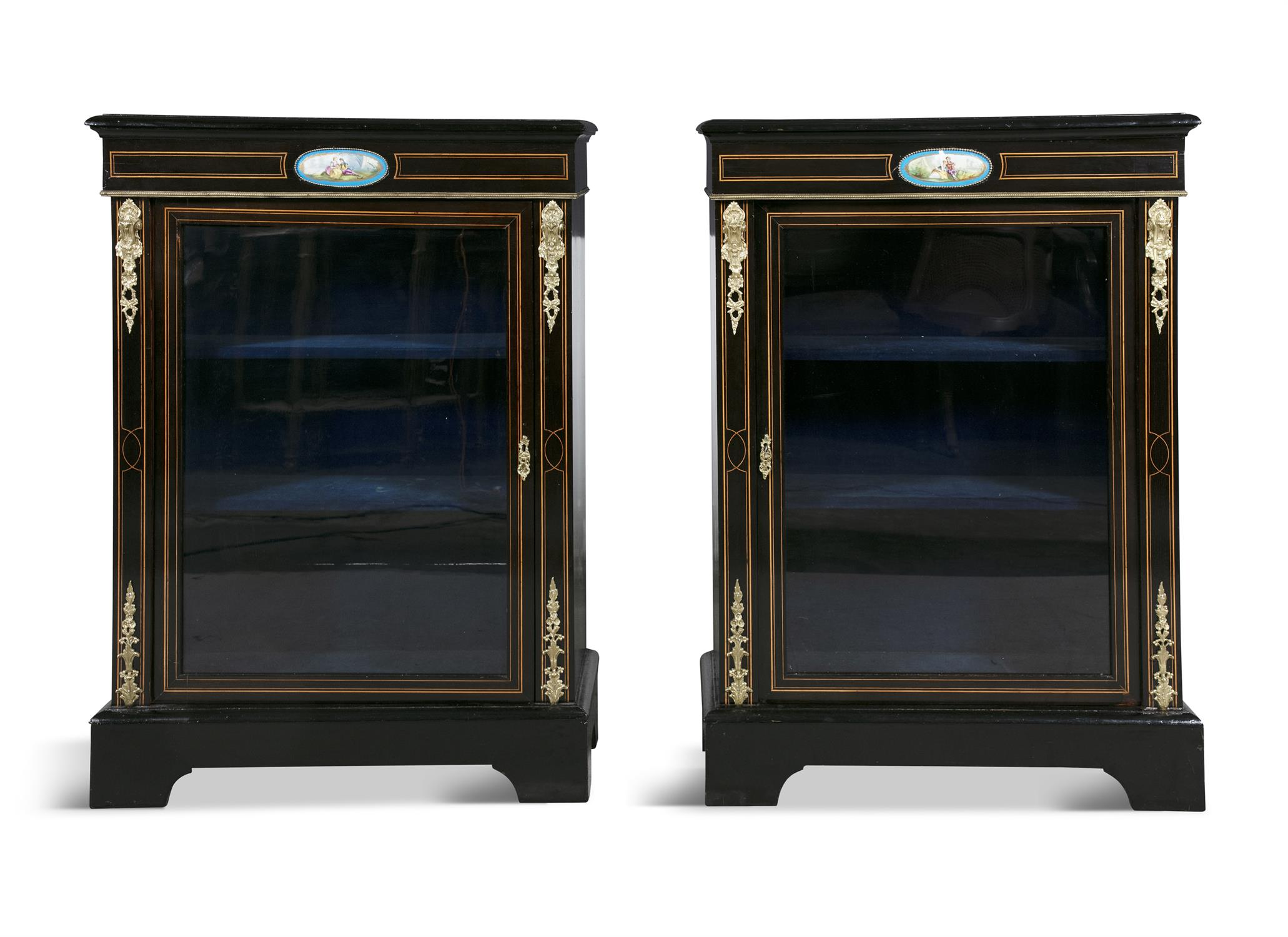 A PAIR OF 19TH CENTURY BRASS MOUNTED EBONISED CABINETS, of rectangular form, the tops with moulded
